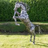 large metal rearing horse sculpture