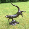 Swimming Otter, life size sculpture in Bronze