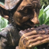 Bronze goblin Pan playing flute large sitting sculpture